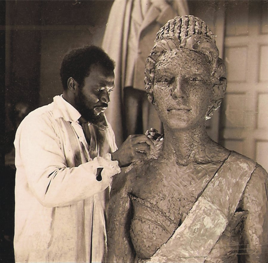 Ben Enwonwu working on a bronze sculpture of Queen Elizabeth II in the studio of Sir William Reid-Dick. Courtesy The Ben Enwonwu Foundation.jpg